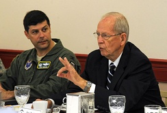 Retired General Larry Welch speaks at the Defense Science Board breakfast as Colonel Andrew Gebara, the 2nd Bomb Wing Commander, listens at Barksdale Air Force Base, on August 28, 2012.