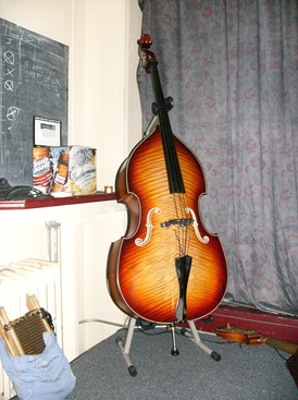 Upright bass used by a bluegrass group; the cable for a piezoelectric pickup can be seen extending from the bridge.