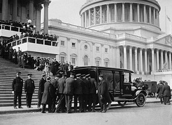 Champ Clark's casket being loaded into a hearse outside the United States Capitol, flag at half staff, March 5, 1921