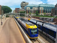 Two Metro Green Line trains on the University of Minnesota–Twin Cities campus