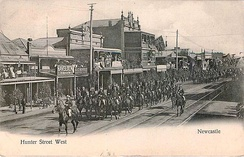 A parade of mounted soldiers along Hunter Street West, c. 1908