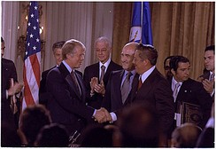 Jimmy Carter and Omar Torrijos shake hands moments after the signing of the Torrijos-Carter Treaties.