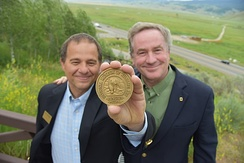 National Museum Wildlife Art Director Steve Seamons and National Geographic Photographer Joel Sartore pose with the Rungius Medal in June, 2017.