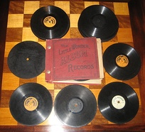A selection of gramophone records and an album