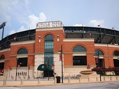 The red brick facade of Camden Yards was designed by Populous to blend into the surrounding neighborhood of downtown Baltimore, especially the nearby B&O Warehouse.