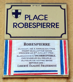 "La Place Robespierre in Marseille with the inscription: ""Lawyer, born in Arras in 1758, guillotined without trial on 27 July 1794. Nicknamed L'Incorruptible. Defender of the people. Author of our republican motto: Liberté Égalité Fraternité""."