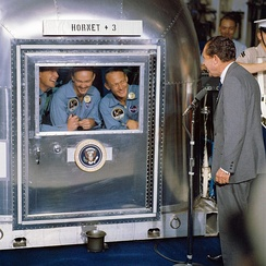 Nixon visiting the Apollo 11 astronauts in quarantine aboard USS Hornet