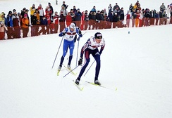 Skiers employing step turns, while descending during a 2006 FIS World Cup Cross Country competition in Otepää, Estonia.