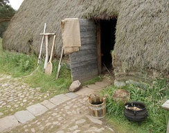 Thatched house in 'Baile Gean' township, Highland Folk Museum illustrates rural poverty.
