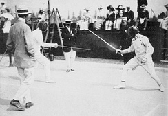 Patton (at right) fencing in the modern pentathlon of the 1912 Summer Olympics