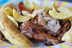 Roast chicken (koku choma), chips, and roast banana (ndizi choma)