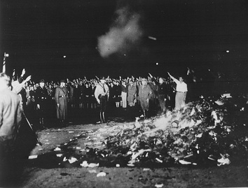A Nazi book burning on 10 May 1933 in Berlin, as books by Jewish and leftist authors are burned[456]