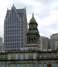 Wayne County Building (completed 1902) downtown by John and Arthur Scott, One Detroit Center (1993) in the back