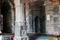 The interior of the black stone Kusumba Mosque, one of Bangladesh's many acclaimed Sultanate-era mosques.[263]