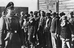 Boys' roll call at main children's concentration camp in Łódź (Kinder-KZ Litzmannstadt).  A sub-camp was KZ Dzierżązna, for Polish girls as young as eight.