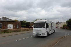 Lincolnshire mobile library at Pode Hole. Lincolnshire County Council operate five routes, covering small villages in this large, sparse, county.  Each location is visited once a month.[22]