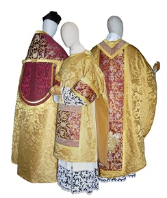 Renaissance styled vestments which is used by the Catholic clergy: A chasuble, dalmatic, cope, and a biretta