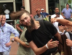 A participant at the Unite the Right rally gave a Nazi salute and was subsequently assaulted by counter-protesters.
