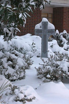 Snow-covered Celtic cross in a Presbyterian memorial garden