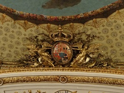 Royal coat of arms above proscenium
