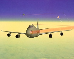 Artist impression of two YAL-1As shooting down ballistic missiles. The laser beams are highlighted red for visibility (in reality, they would be invisible to the naked eye).