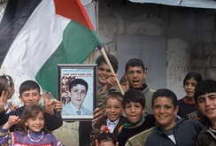Children waving a Palestinian flag, West Bank