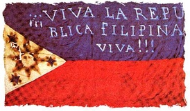 "Early flag of the Filipino revolutionaries (""Long live the Philippine Republic!!!""). The first two constitutions were written in Spanish."