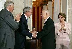 President George W. Bush along with House Majority Leader Steny Hoyer and House Speaker Nancy Pelosi congratulate Borlaug during the Congressional Gold Medal Ceremony on July 17, 2007.