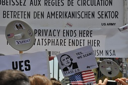 Germans protesting against the NSA surveillance program PRISM at Checkpoint Charlie in Berlin