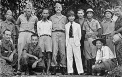 Hồ Chí Minh (third from left, standing) with the OSS in 1945