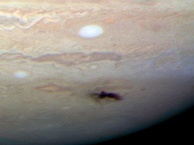 Hubble image taken on July 23, 2009, showing a blemish about 8,000 km (5,000 mi) long left by the 2009 Jupiter impact event.[177]