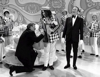 John Wayne and Tiny Tim helped Laugh-In celebrate its 100th episode in 1971.