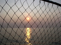 Sunset on Lake Erie seen through a fishing net