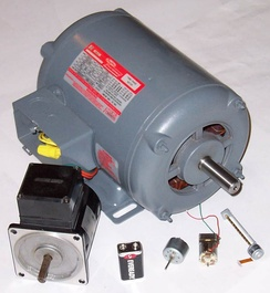 Various electric motors, compared with a 9 V battery.