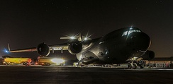 An RAF C-17 aircraft being refueled at RAF Brize Norton before delivering Iraq-bound aid to RAF Akrotiri in Cyprus.