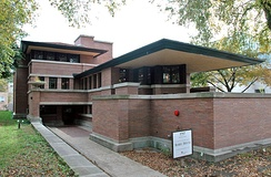 The Robie House, designed by Frank Lloyd Wright, is an example of a property listed by means of criterion C.[13]