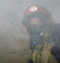 A Russian firefighter with a head of duty shift fire station helmet.