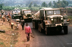 Convoy of American military vehicles bring fresh water from Goma to Rwandan refugees located at camp Kimbumba, Zaire in August 1994