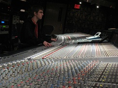 A sound engineer at the controls of a SSL9000J mixer.