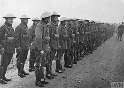 Company of Vietnamese troops parading for ceremonial investiture with decorations at Etampes in World War I