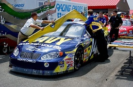 NASCAR officials are using a template to inspect Casey Atwood's 2004 Busch Series Chevrolet Monte Carlo