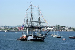 USS Constitution fires a salute during its annual Fourth of July turnaround cruise