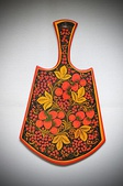 A Khokhloma painting on a cutting board