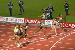 The finish of a women's 100 m race