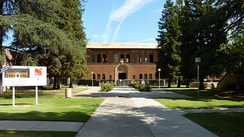The Old Administration Building, the first permanent structure on California State University, Fresno's original campus, is now part of Fresno City College and listed on the National Register of Historic Places.[84]
