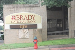 The Brady National Bank is located about the courthouse square.