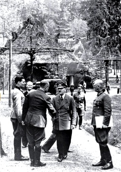 At Rastenburg on 15 July 1944. Stauffenberg at left, Hitler center, Keitel on right. The person shaking hands with Hitler is General Karl Bodenschatz, who was seriously wounded five days later by Stauffenberg's bomb.
