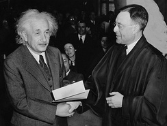 Physicist Albert Einstein receiving his certificate of U.S citizenship from Judge Phillip Forman in 1940.[1]
