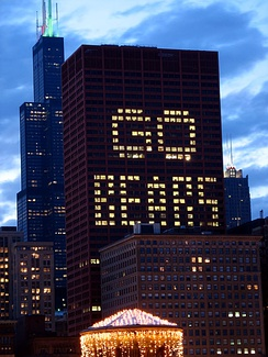 "The CNA Center in Chicago flashes a ""GO BEARS"" window display before a Bears Sunday Night Football game"