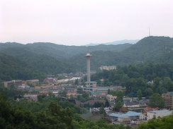 The resort city of Gatlinburg borders Great Smoky Mountains National Park, which is the most visited national park in the United States as of 2019.[242]
